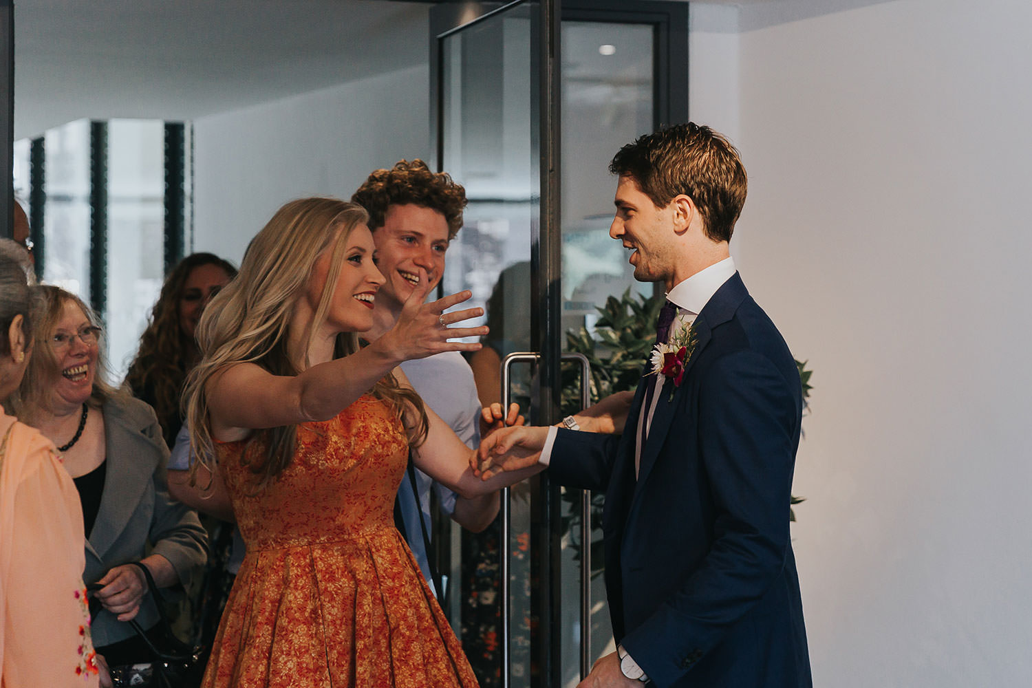 groom welcomes guests at OXO2 Wedding London