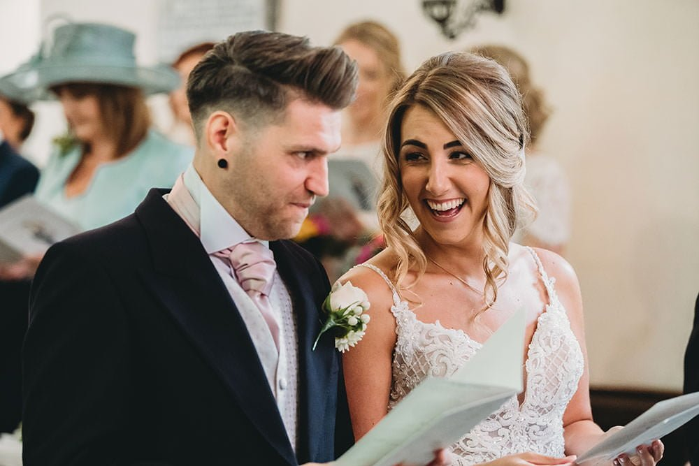 barnston lodge wedding bride and groom in church