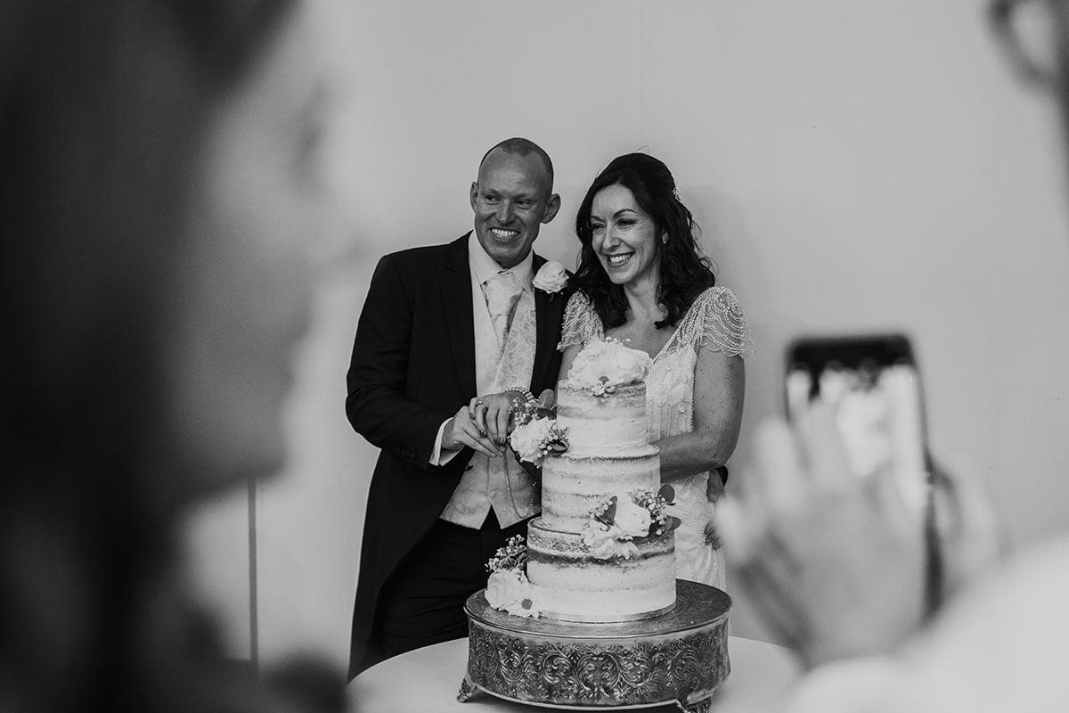 braxted park summer wedding cake cut